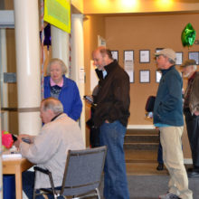 People lined up to get their new key cards and learn about the new registration system.